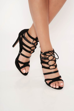 Black sandals with thin straps ribbon fastening