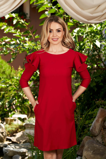LaDonna with easy cut red dress with ruffled sleeves