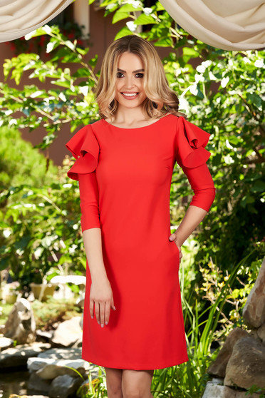 LaDonna with easy cut coral dress with ruffled sleeves