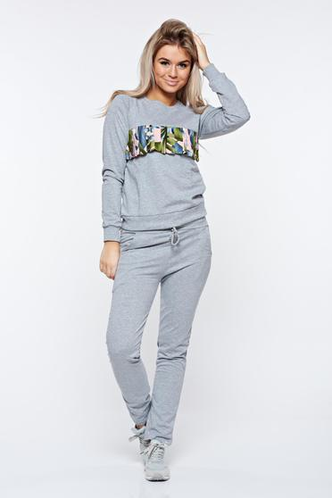 Grey set cotton with pockets is fastened around the waist with a ribbon casual