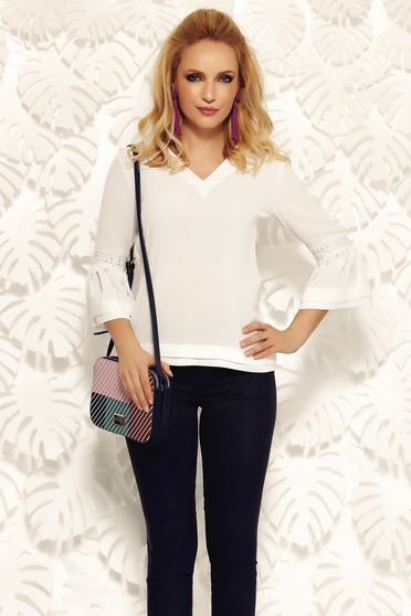 Fofy white elegant with easy cut women`s blouse airy fabric with ruffled sleeves with fringes