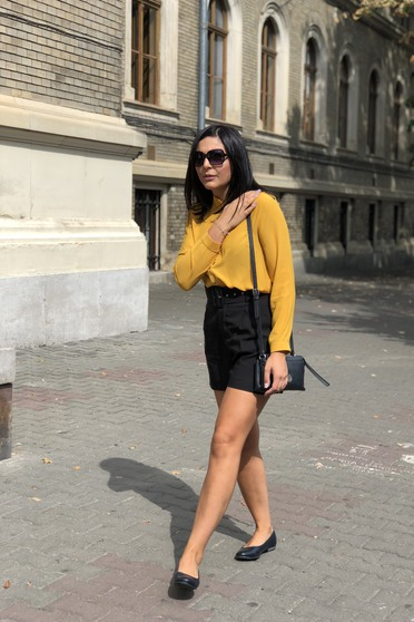 Elegant flared women`s shirt slightly transparent fabric mustard
