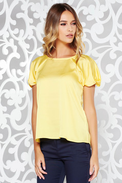 Yellow elegant flared women`s blouse from satin fabric texture short sleeve