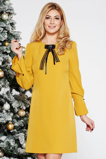 Mustard elegant a-line dress slightly elastic fabric with 3/4 sleeves accessorized with breastpin