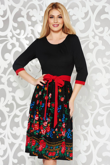 Black elegant cloche dress slightly elastic fabric with floral prints accessorized with tied waistband