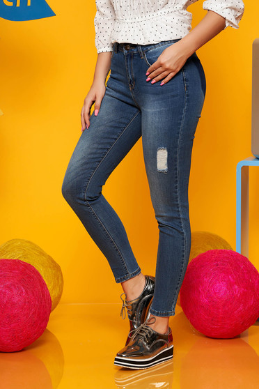 Blue trousers casual denim with medium waist small rupture of material