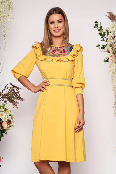 LaDonna yellow elegant flared dress slightly elastic fabric embroidered with inside lining accessorized with tied waistband
