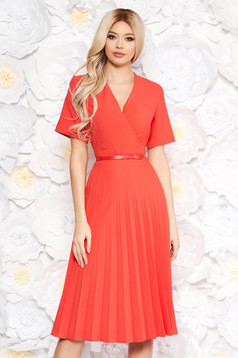 Coral dress pleats of material with v-neckline flaring cut