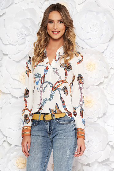 White elegant flared women`s shirt with v-neckline airy fabric with graphic details