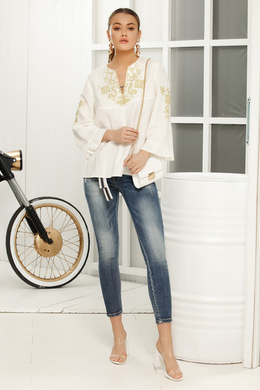White flared women`s blouse with 3/4 sleeves airy fabric with embroidery details
