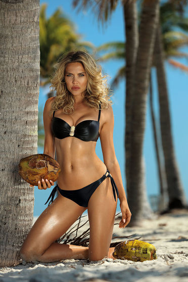 Black swimsuit from two pieces brazilian slip with balconette bra accessorized with breastpin