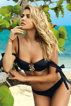 Black swimsuit from two pieces with balconette bra accessorized with breastpin with classical slip