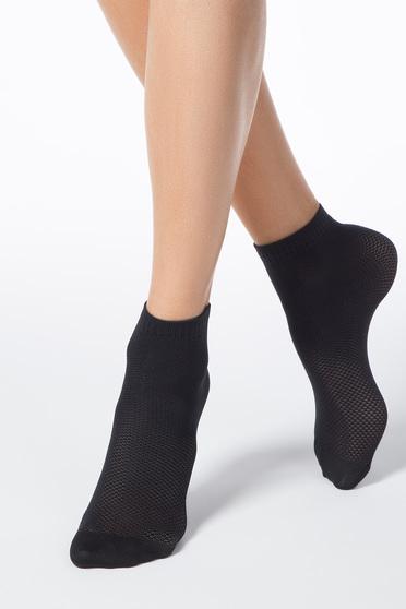 Black socks from elastic fabric net stockings