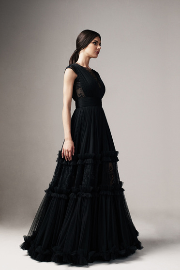 Ana Radu black occasional cloche dress with v-neckline with lace details accessorized with tied waistband