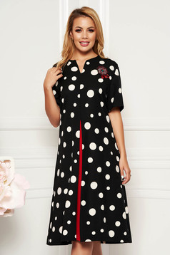 Black elegant a-line dress with pockets slightly elastic fabric accessorized with breastpin
