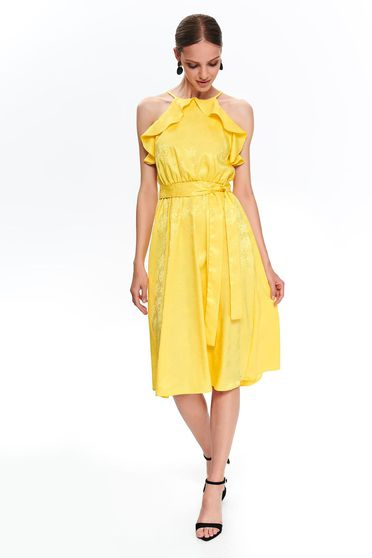 Yellow midi cloche dress with braces with ruffle details accessorized with tied waistband