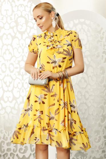 Yellow daily midi cloche dress voile fabric accessorized with breastpin