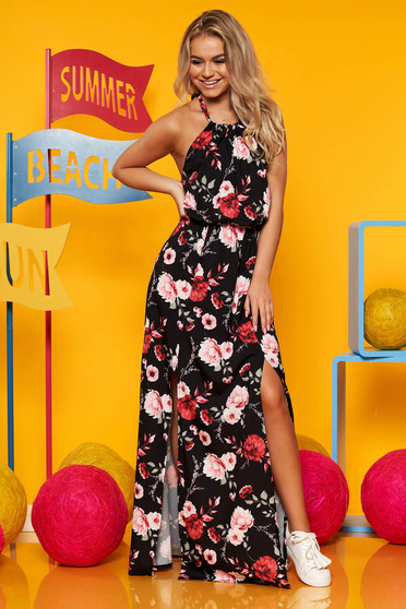 Black dress from veil fabric with floral print is fastened around the neck with elastic waist long