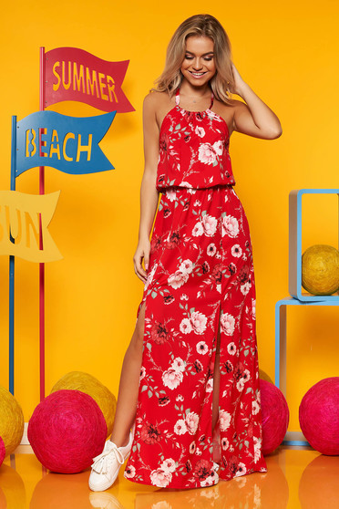 Red dress from veil fabric with floral print is fastened around the neck with elastic waist long