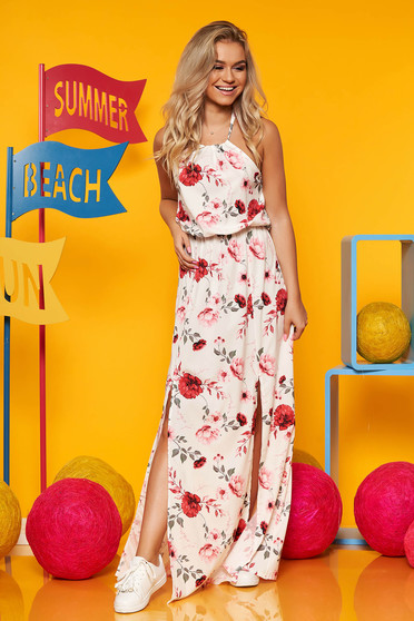 White dress from veil fabric with floral print is fastened around the neck with elastic waist long