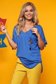 Blue women`s blouse both shoulders cut out with v-neckline with an accessory