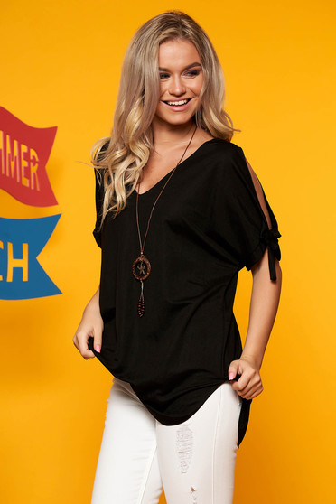 Black women`s blouse both shoulders cut out with v-neckline with an accessory