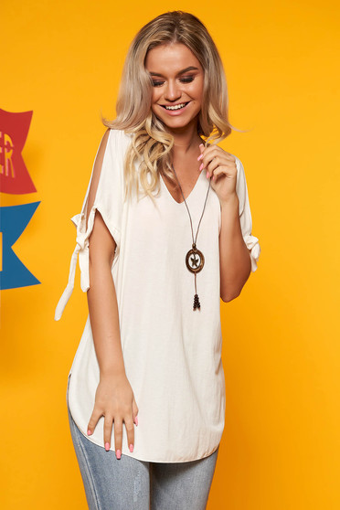 White women`s blouse both shoulders cut out with v-neckline with an accessory