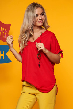 Red women`s blouse both shoulders cut out with v-neckline with an accessory
