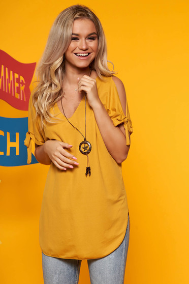 Mustard women`s blouse both shoulders cut out with v-neckline with an accessory