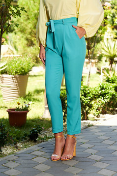 Long casual turquoise trousers with front pockets accessorized with tied waistband