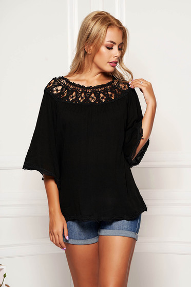 Black airy fabric women`s blouse with easy cut casual