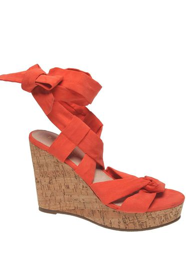 Orange sandals casual is fastened around the leg
