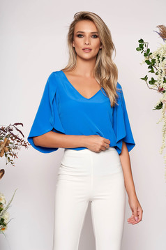 Blue women`s blouse casual flared with v-neckline with cut-out sleeves