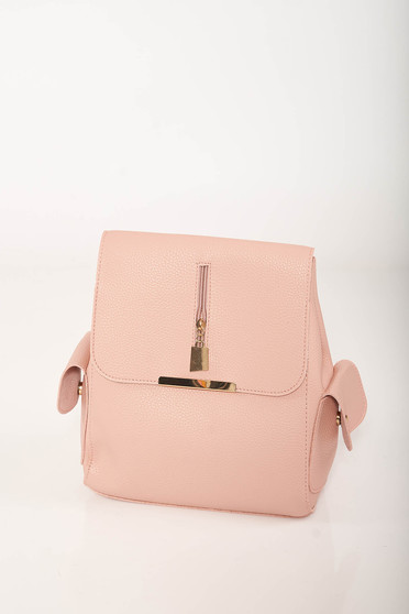 Casual pink backpacks from faux leather with lateral pockets and adjustable straps