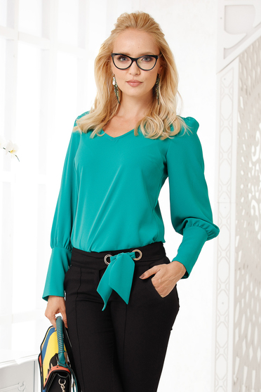 Green women`s blouse elegant flared with v-neckline from veil fabric thick fabric with an accessory