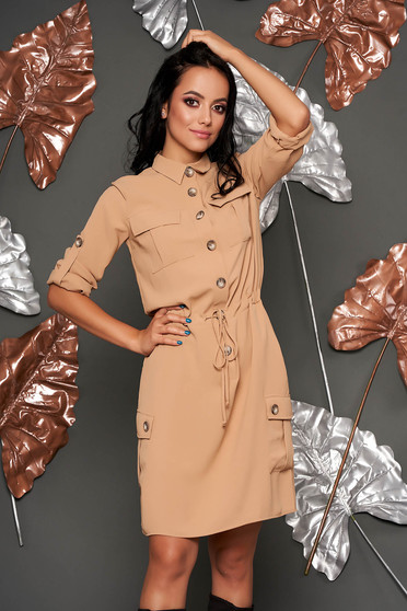 Cream dress casual short cut flared with pockets is fastened around the waist with a ribbon with buttons
