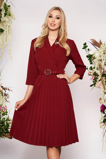 Burgundy dress elegant midi cloche cloth thin fabric folded up wrap over front accessorized with breastpin accessorized with belt