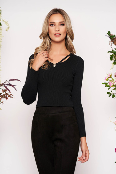 Black knitted tented women`s blouse long sleeve with v-neckline front cut-out design accessorized with breastpin