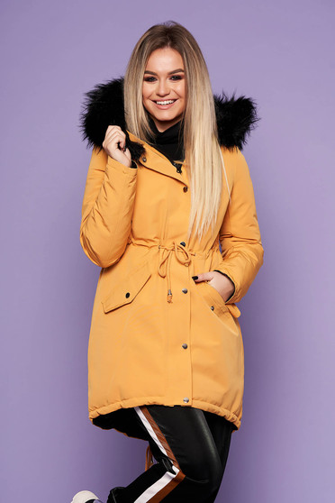 Mustard casual jacket with easy cut with undetachable hood with faux fur accessory is fastened around the waist with a ribbon with inside lining