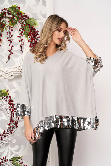 Grey women`s blouse with sequin embellished details short sleeves from elastic fabric with easy cut thin fabric short cut