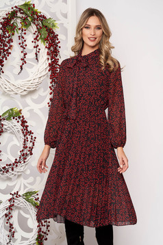 Red dress long sleeved flaring cut pleats of material from veil elastic waist