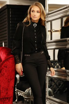 Elegant women`s shirt with easy cut from veil fabric with lace details accessorized with breastpin black