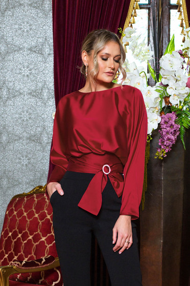 Red women`s blouse accessorized with tied waistband buckle accessory long sleeved occasional from satin