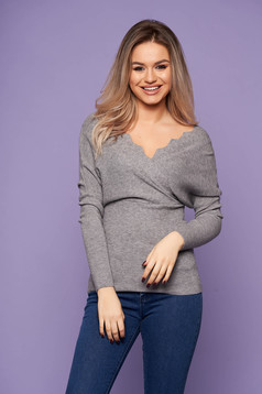 Grey women`s blouse casual short cut with v-neckline knitted arched cut long sleeved