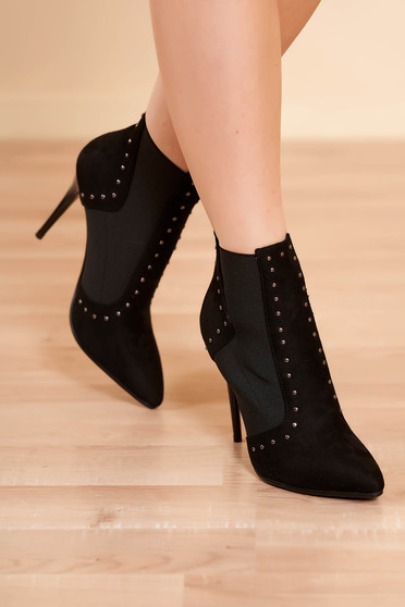 Ankle boots black elegant from ecological leather with high heels slightly pointed toe tip with metallic spikes