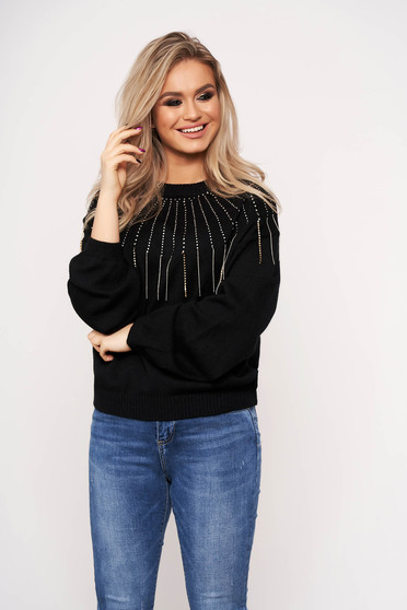 Black sweater long sleeve with crystal embellished details with rounded cleavage accessorized with chain casual