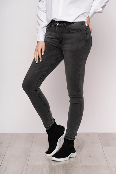 Darkgrey jeans casual with tented cut slightly elastic fabric small rupture of material