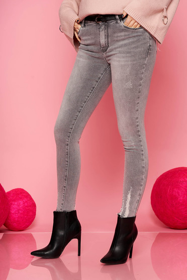 Grey jeans casual denim with medium waist with tented cut small rupture of material