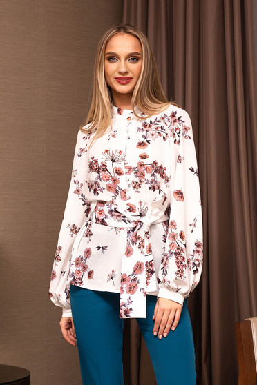 White women`s blouse elegant short cut flared from veil fabric accessorized with tied waistband with puffed sleeves