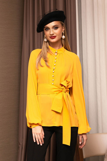 Yellow women`s blouse elegant flared bell sleeves with puffed sleeves from veil fabric